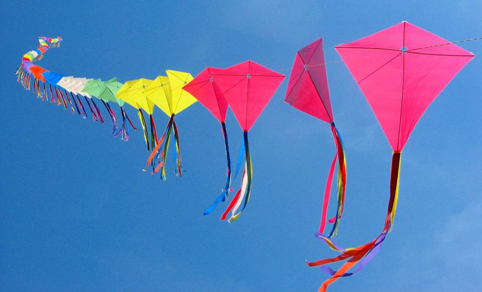 A rainbow-colored kite train. Photo by Rona Proudfoot/Flickr, via TheGauntlet.ca.