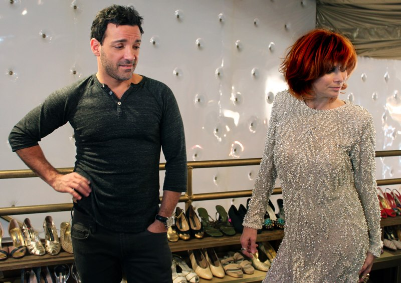 "Linda Ramone tries on a beaded 1980s Victoria Royal dress at The Way We Wore while stylist George Kotsiopoulos watches. She wore this dress to the 2012 Grammys. Via the ""L.A. Frock Stars"" Facebook page."