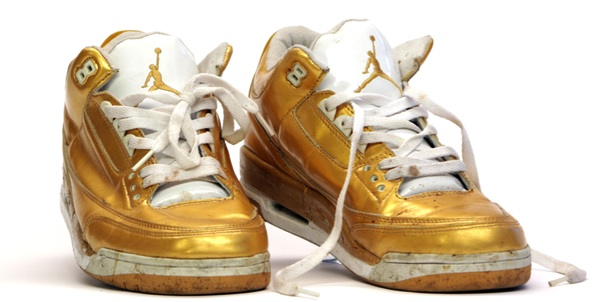 The last pair of Al Goldstein's gold lamé Nike Air Jordan sneakers. Via mmuseumm.com