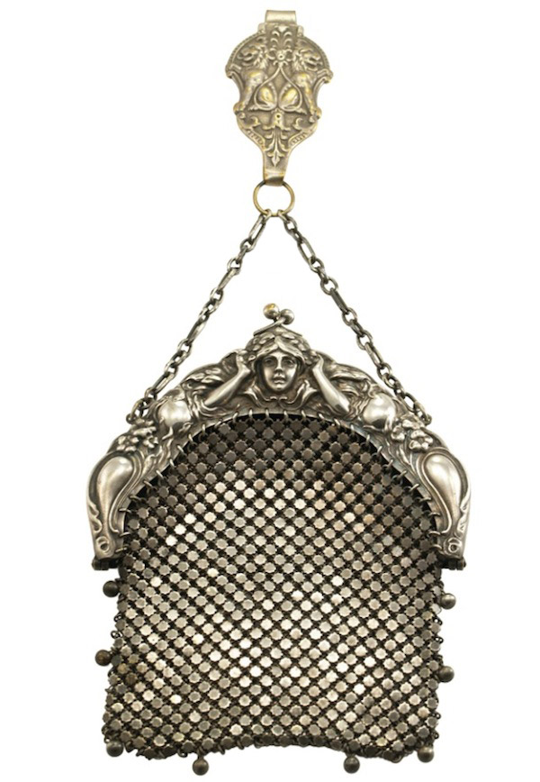 "An E.A. Bliss silver mesh chatelaine purse, circa 1907 to 1915 features an Art Nouveau motif with flowers and a nymph. (From ""The Napier Co."")"