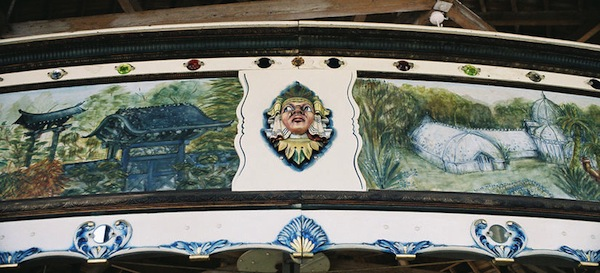 The rounding boards on the 1914 Herschell-Spillman carousel at Golden Gate Park in San Francisco have landscapes, as well as theatrical shields. (© Aaron Shepard, via carousels.org)