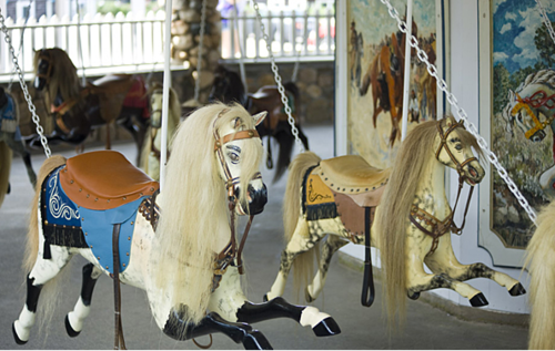 "This ""flying horses"" carousel in Watch Hill, Rhode Island, is thought to have been made by Charles W. Dare in 1876. One of the oldest carousels in the United States, this children-only ride was part of a traveling carnival until 1879."