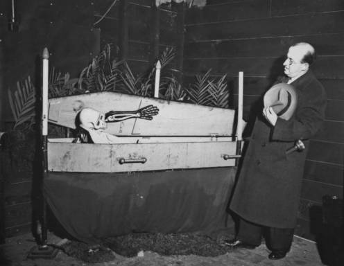 A man, possibly an amusement ride operator, approaches a stunt where a skeleton emerges from a coffin at Laff in the Dark at Playland Park in Rye, New York, circa 1934. (Courtesy of the Westchester County Archives)