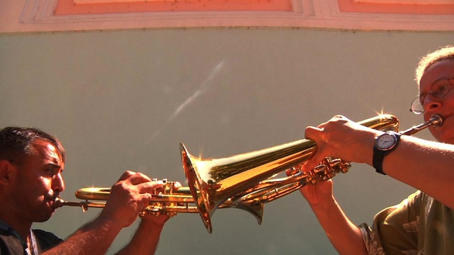 "Ćerimović and Zlatne Uste flugelhorn player Catherine Foster riff off of together. (Still from ""Brasslands"" courtesy of the Meerkat Media Collective)"