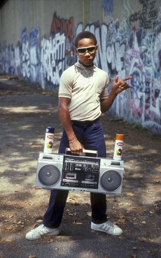 A young B-boy struts his stuff in New York, circa 1980. Photo by Martha Cooper.