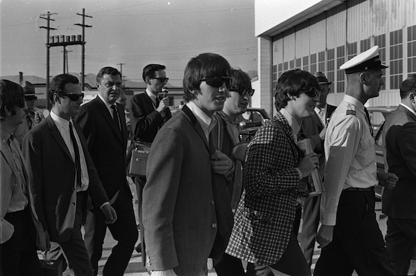 The Beatles and their manager, Brian Epstein (at left, in sunglasses and white shirt), arrive in Vancouver, B.C., 1964. Photo: Deni Eagland/Vancouver Sun PNG Merlin Archive.