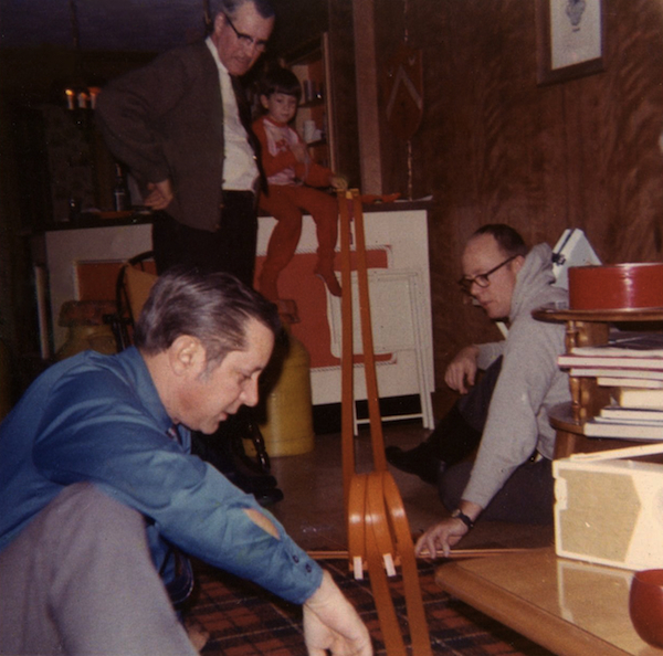 Above: Schools at age six, with his dad, Bill (in the blue shirt), on Christmas morning, 1970. Top: Blissing out with Widespread Panic during the band's 2013 fall tour.