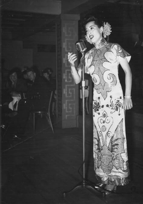 Elly Chui sings at the Kubla Khan in a sparkly update of a traditional cheongsam.
