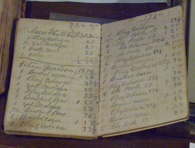 After the Civil War, Thomas B. Hill, owner of Buckner Hill Plantation, used this ledger to keep track of the wages paid to his sharecroppers and their debts to him. (Photo by Arnold Modlin)