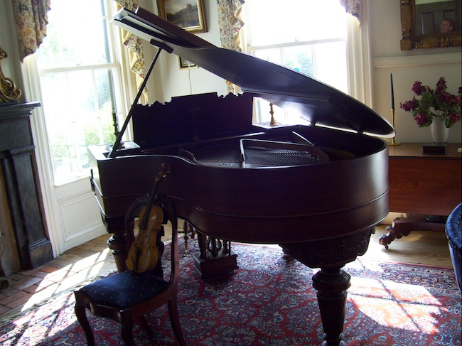 A grand piano in the music room at Buckner Hill Plantation. (Photo by Arnold Modlin)