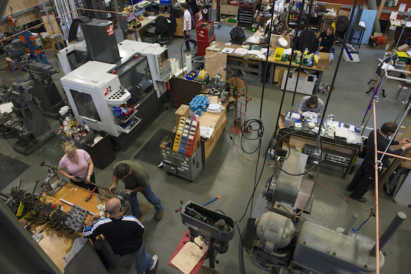The Exploratorium shop: The tops of the Cleereman and DoAll are at bottom-right, while the modern gray object in the upper-left is a CNC (computer numerical control) machine. Photo, Amy Snyder.