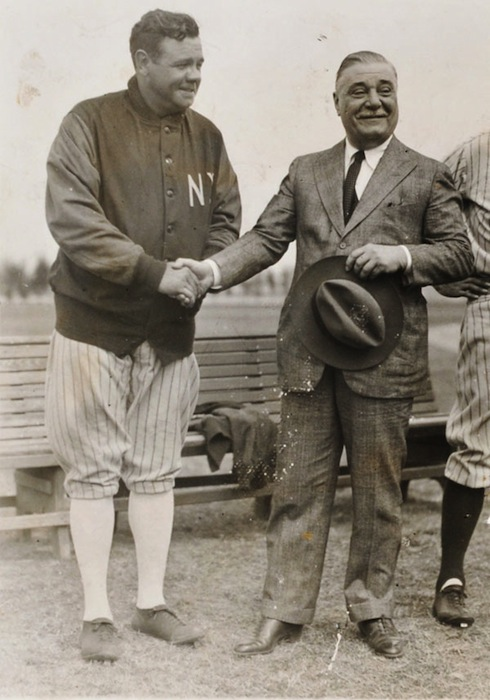 Above: An Associated Press photo of Babe Ruth and Yankees owner Jacob Ruppert, Jr., 1930. Photo via Legendary Auctions. Top: A tin-over-cardboard sign from the late 1930s. Photo by Ken Quaas.