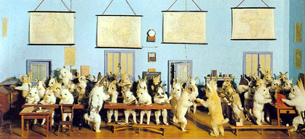 "A 1930s photo Walter Potter's ""Rabbit School"" diorama, when it was still on display at his Bramber, Sussex, museum. Potter was an early amateur taxidermist who created dioramas of animals doing human activities in the mid-1800s. (Via Wikipedia, Creative Commons license)"