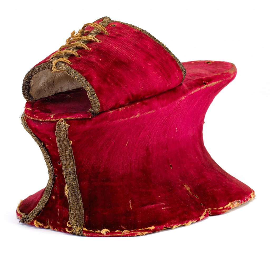 Though almost always hidden, Italian chopines were still made from elegant materials, like this red velvet style from the 16th century. Courtesy the Bata Shoe Museum.