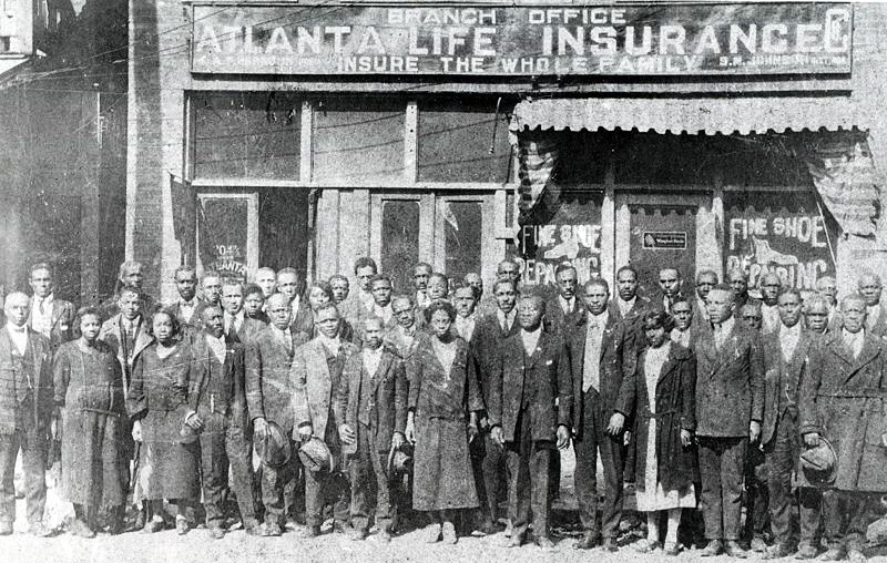 Barber Alonzo Herndon founded the Atlanta Life Insurance Company in 1905. This photo shows the business and its staff, circa 1922.