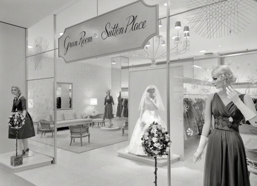 "In 1950s and '60s, Bloomingdale's advertised exclusive designs offered in its ""Green Room,"" such as these gowns by the label Sutton Place at the Hackensack store in 1959. (Via the Gottscho-Schleisner Collection at the Library of Congress)"