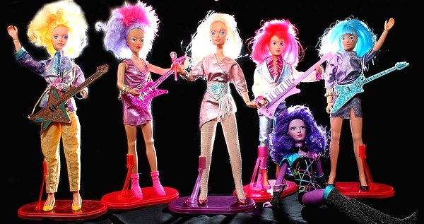 The original 1986 Hasbro Jem and the Holograms dolls with, from left, Video, Shana, Jem, Kimber, supercomputer Synergy, and Aja. (Via Allyeska's Flickr)