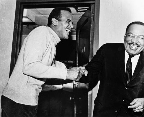 "Harry Belafonte and Dr. Martin Luther King, Jr., have a laugh. The actor put a good deal of money into the civil-right movement; once he raised $50,000 to bail King out of jail in Birmingham, Alabama. (Photo via the book ""My Song"" by Alfred A. Knopf)"