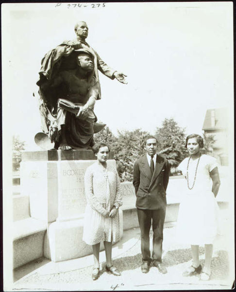 Zora Neale Hurston, Langston Hughes, and Jessie Redmon Fauset visit the grave of Booker T. Washington at Tuskegee Institute in 1927.