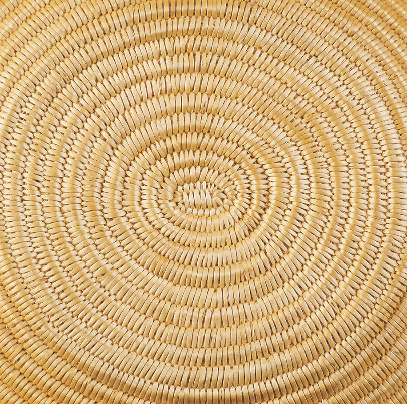 Detail of the bottom of an oval-coiled Washoe basket. Notice that it coils to the left.