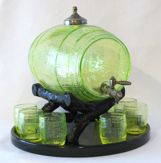 "This Vaseline keg and set of glasses was made in the early 20th century by Cambridge Glass Co. of Cambridge, Ohio. Photo via Dave Peterson at <a href=""http://www.vaselineglass.org/"">VaselineGlass.org</a>"