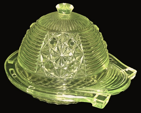 "A Vaseline glass butter dish and cover in the shape of a horseshoe and jockey's cap. Attributed to King Glass of Pittsburgh, late 19th century. Photo via Dave Peterson at <a href=""http://www.vaselineglass.org/"">VaselineGlass.org</a>"