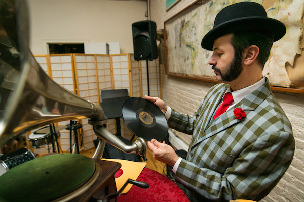 Michael Cumella hosts WMFU's Antique Phonograph Music Program and DJs from 78s at parties and weddings using a wind-up phonograph. (Photo by Kelly WIlliams)