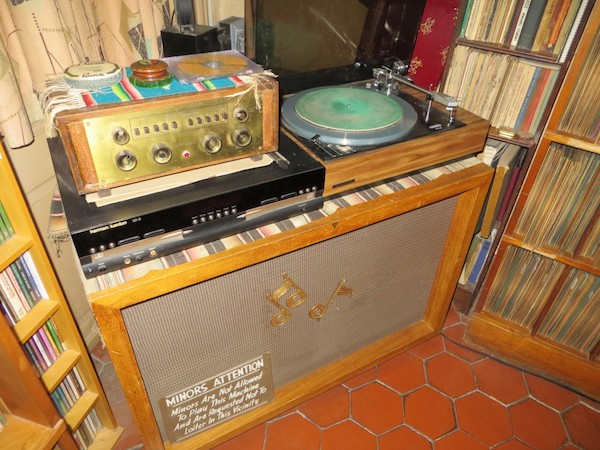 "In Crumb's record room, a sign on the speaker for his turntable reads: ""Minors Are Not Allowed To Play This Machine And Are Requested Not To Loiter In This Vicinity."" (Via <a href=""http://www.eastriverstringband.com/radioshow/?p=1023"">John's Old Time Radio Show</a>)"