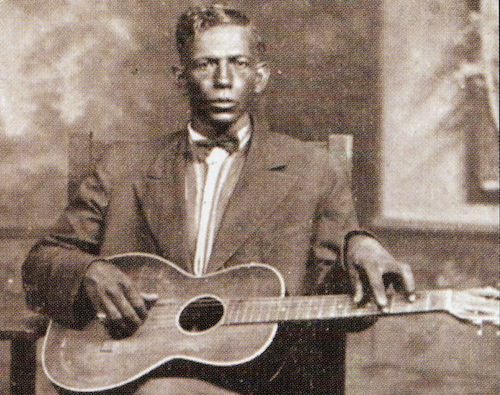 A detail of the only known photo of Charley Patton, circa 1929. The photo is now in the collection of John Tefteller and can be purchased in calendars and as a poster at his Blues Images website. (Via John's Old Time Radio Show)