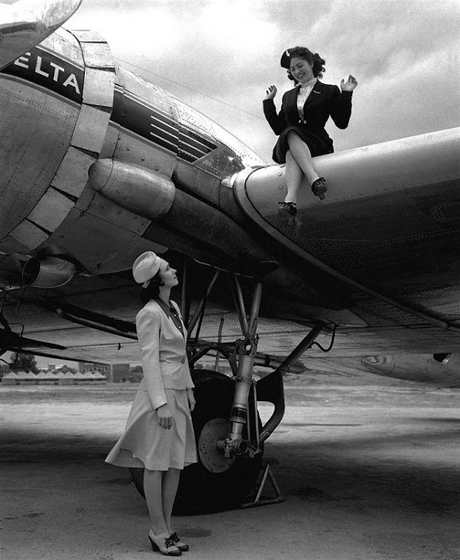 Delta Airlines flight attendants model their uniforms for the summer, at left, and winter, at right, in the early 1940s. (Via Museum of Flight)