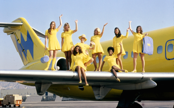 Hughes Airways flight attendants pose on a plane's wing in 1971. (Via Museum of Flight)