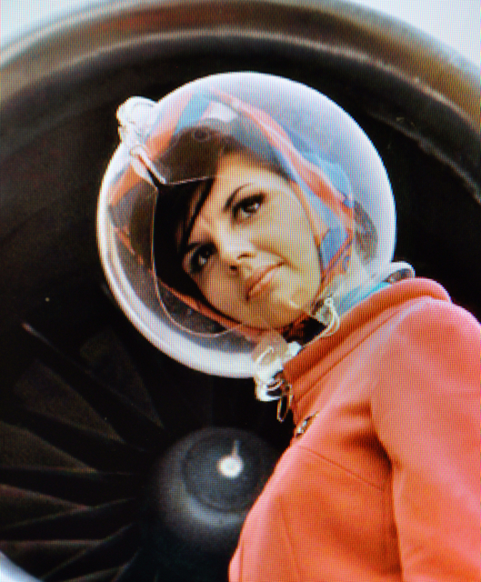 "In 1965, Pucci gave Braniff stewardesses a hat that tied around the neck and a ""Space Bubble"" helmet to protect the hat from the rain. (Via TheGlassBox.typepad.com)"