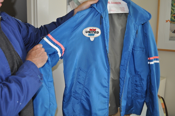 "Lappin holds up a United Airlines ramp jacket from the late 1960s-early 1970s, back when the airline was calling its 747s ""Friend Ships."" (Photo by Lisa Hix)"