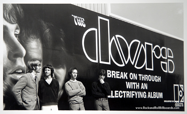 The Doors posing against their 1967 billboard, which supposedly started the trend. Courtesy of Clear Channel Outdoor Archives.