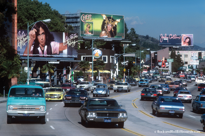 A view of Sunset in 1976, with hand-painted billboards for Eddie Money, Cher, and Judy Collins. Photo by Robert Landau.