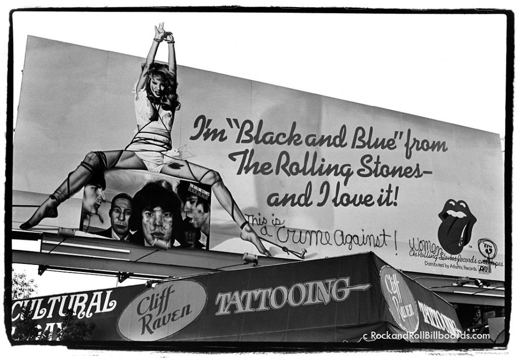 "Some billboards created controversy, like this 1976 ad for ""Black and Blue,"" which Landau captured complete with outraged graffiti about violence against women. Photo by Robert Landau."